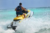 picture of waverunner  - Man on Wave Runner turns fast on the water - JPG
