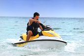 stock photo of waverunner  - Man on Wave Runner turns fast on the water - JPG