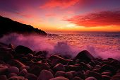 Purple Tinted Waves Breaking On A Rocky Beach At Sunset Over Porth Nanven In The Cot Valley Of Cornw poster