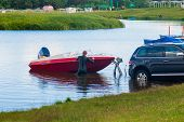 A Man Pulls A Boat Out Of The Lake. Boat Launch. The Machine Pulls The Boat Out Of The Water. Fishin poster