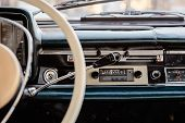 Retro Styled Image Of An Old Car Radio And Dashboard Inside A Classic Car poster
