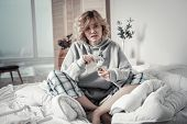 Depressed Lonely Woman Wearing Pajamas Sitting In Bed poster