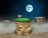 Stacks Of Coins With Land On Cracked Earth At The Night Background. Sale Of Land Concept. poster