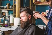 Barber With Hair Clipper Works On Hairstyle For Man With Beard, Barbershop Background. Barber Stylin poster