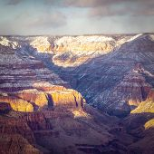 Evening Image Looking Into The Grand Canyon With Dramatic Evening Sunlight Casting Light And Shadows poster