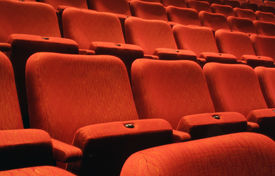 stock photo of movie theater  - Rows of numbered seats in a theatre - JPG