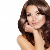 Beautiful Brunette Woman Portrait with healthy Hair.Clear Fresh Skin.Smiling Girl Isolated on a Whit