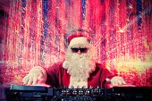 picture of disc jockey  - DJ Santa Claus mixing up some Christmas cheer - JPG
