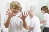 Children Washing Hands In Classroom Sinks poster
