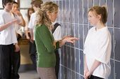 picture of pre-teen girl  - Female teacher reprimanding a female student - JPG