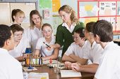 stock photo of hair integrations  - Students receiving chemistry lesson in classroom - JPG