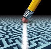 stock photo of maze  - Finding solutions and solving a problem searching the best creative answers against a complicated and complex three dimensional maze having a clear shortcut path created by erasing the labyrinth with a pencil eraser - JPG