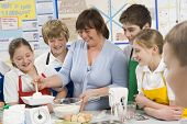picture of tweeny  - Students preparing ingredients in cooking class with teacher - JPG