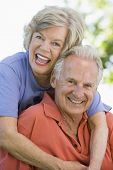 stock photo of senior adult  - Senior couple sitting outdoors - JPG