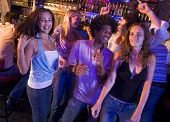 stock photo of hair integrations  - Young people dancing in a bar - JPG