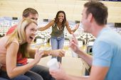 stock photo of hair integrations  - Woman bowling with friends - JPG