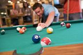 stock photo of hair integrations  - Man playing pool - JPG
