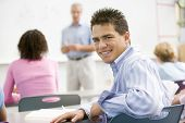 pic of hair integrations  - Male student with other students in classroom - JPG