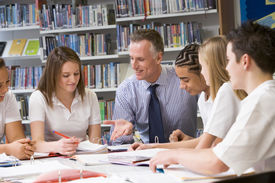 stock photo of student teacher  - Students and teacher in a study group collaborating - JPG