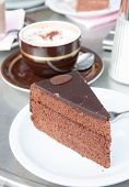 stock photo of tort  - Slice of a Sacher Torte a chocolate cake