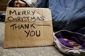 image of hobo  - Man sleeping on the streets at Christmas time - JPG
