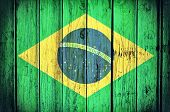 picture of wooden fence  - Official Brazil flag on the wooden background - JPG