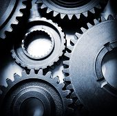 picture of interlocking  - Closeup of metal cog gears - JPG