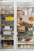stock photo of refrigerator  - Closeup of open refrigerator with food items in commercial kitchen - JPG