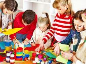 picture of nursery school child  - Child painting at art school - JPG