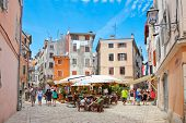ROVINJ, CROATIA - JULY 3: People walk the old town streets on July 3, 2013 in Rovinj, Croatia.Total