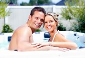 stock photo of tub  - Happy couple relaxing in hot tub - JPG