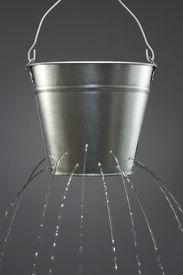 stock photo of nursery rhyme  - Water leaking from bucket - JPG