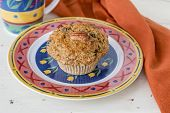 image of pecan  - A homemade pecan carrot muffin on a decorative plate - JPG