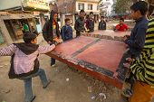 KATHMANDU, NEPAL - DEC 20: Unidentified teenagers from poor families play in table tennis in the slu