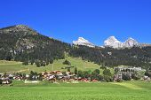 stock photo of chalet  - Gorgeous weather in the resort town of Leysin in the Swiss Alps - JPG