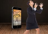Angry businesswoman gesturing against dark room with floorboards