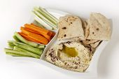stock photo of crudites  - High angle view of a dip tray with hummus - JPG
