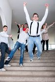 Cheerful highschool students jumping from steps