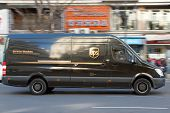VALENCIA, SPAIN - JANUARY 28, 2014: UPS delivery van on the street in Valencia. UPS is one of larges