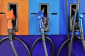 picture of gasoline station  - Several Gasoline Pump Nozzles At Petrol Station - JPG