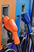 pic of gasoline station  - Several Gasoline Pump Nozzles At Petrol Station - JPG
