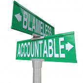 pic of take responsibility  - Accountable and Blameless words on two green road or street signs at an intersection showing the choice between taking or shirking responsibility - JPG