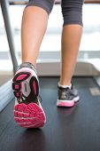 image of treadmill  - Womans feet running on the treadmill at the gym - JPG