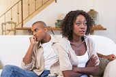 foto of not talking  - Unhappy couple not speaking to each other at home in the living room - JPG