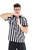 picture of referee  - Stern referee showing time out sign on white background - JPG
