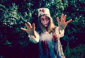 stock photo of walking dead  - Woman zombie walking dead outdoors - JPG