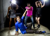 picture of peer-pressure  - Caucasian man falls but confidently plays cool in a dance club - JPG
