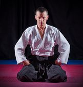 stock photo of aikido  - Aikido fighter on black background - JPG