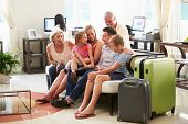 picture of multi-generation  - Multi Generation Family Arriving In Hotel Lobby - JPG