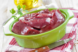 picture of giblets  - Raw liver in a casserole on a table - JPG